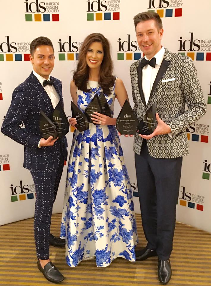 Shayla and two men posing for an image with their awards